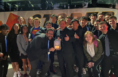 Group photo of Hillsdale Jazz Ensemble and Director posing with their award