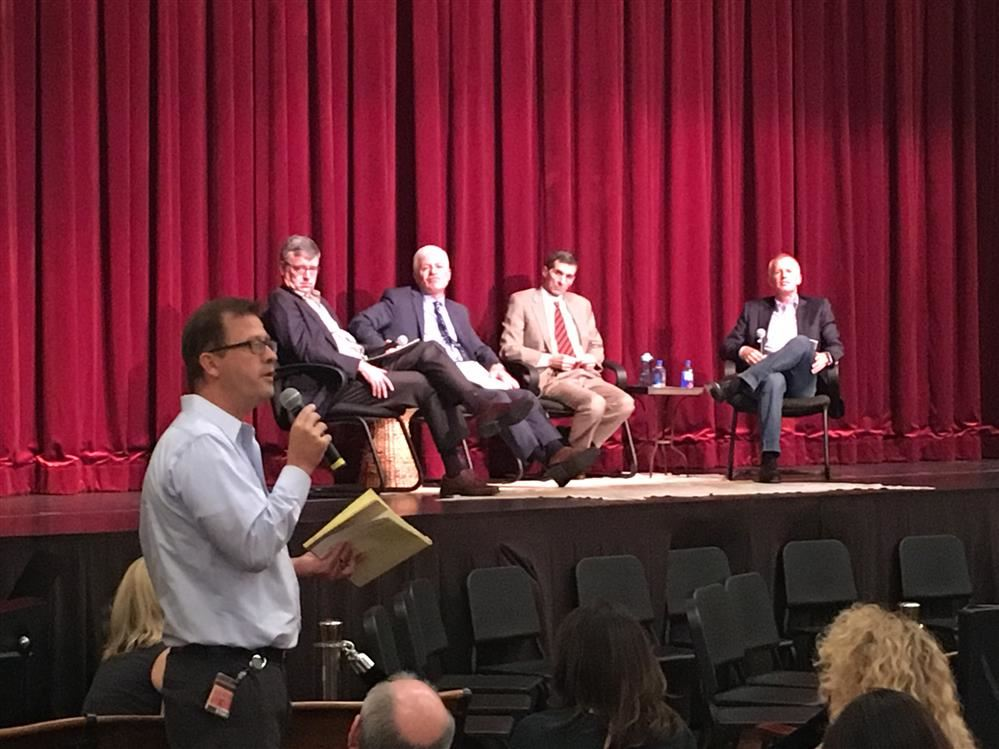 Burlingame High School Principal Paul Belzer Addresses the Crowd as the Panel Looks On