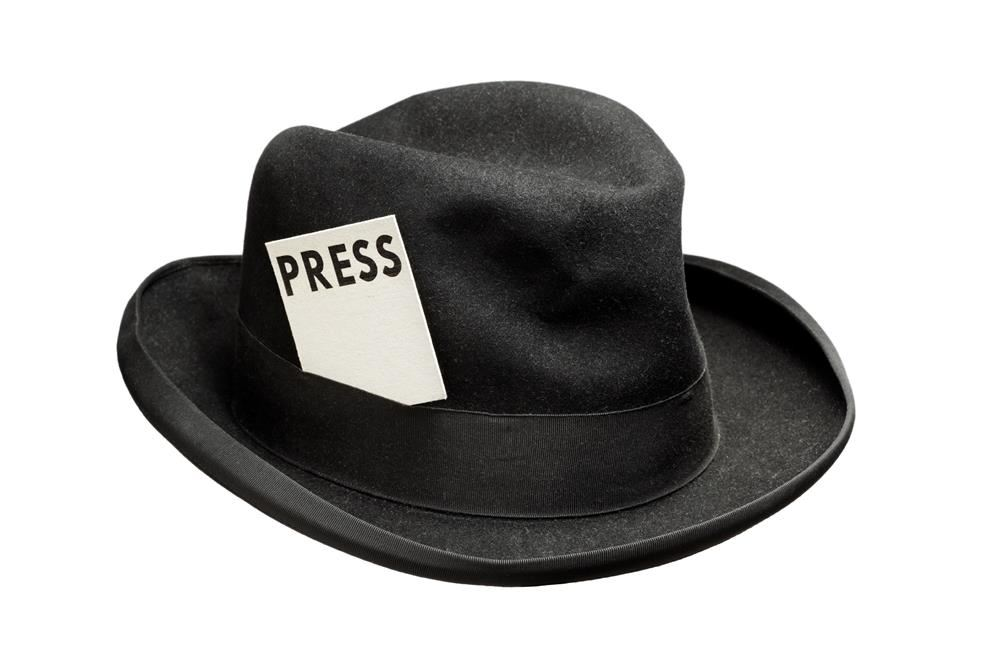 iStock Image of a Traditional Press Cap Worn in the Early Days of Journalism