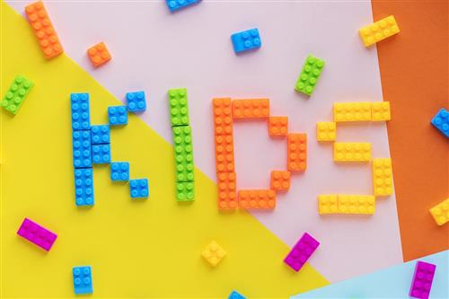 """Kids"" spelled out in colorful leggos"