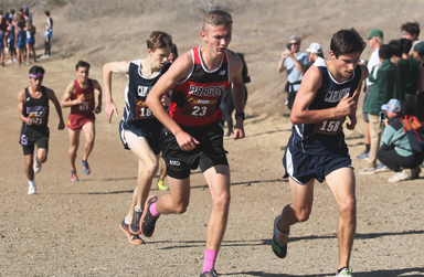 Blaine Reynolds Running up Hill in a Cross Country Competition