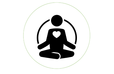 Silhouette of a person sitting crisscross with a heart symbol in the center