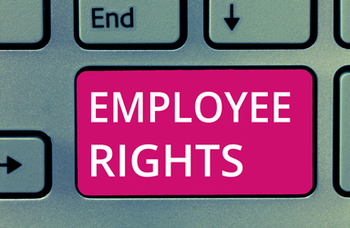 Laptop keyboard with a button that reads: Employee Rights