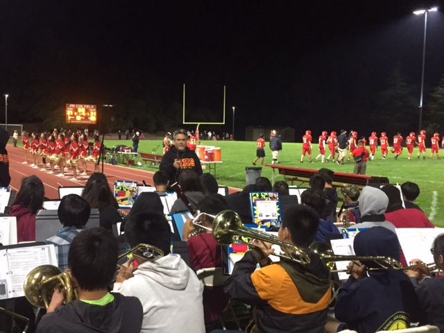 The Mills High Band Performs at the Stadium Light Celebration Where We Gathered with the Community