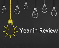 Stock Drawing of chalkboard with light bulbs - text reads: Year in Review