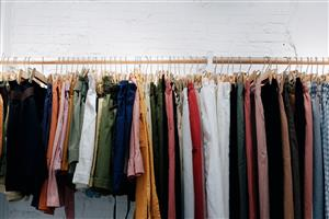 a rack of clothes on hangers