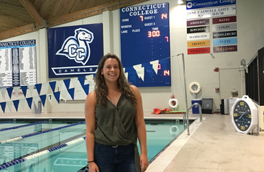 Aragon Senior Maria Sell standing on the pool deck at Connecticut College