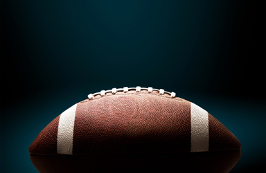 Stock photo of a football on a black background